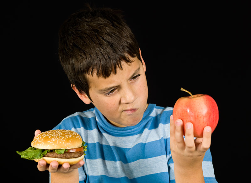 boy with hamburger and apple