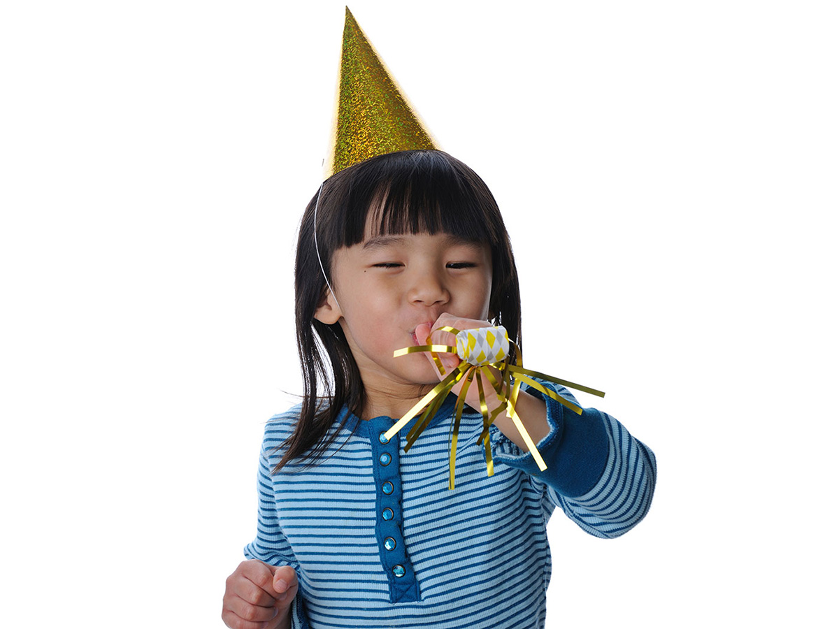 child with birthday hat