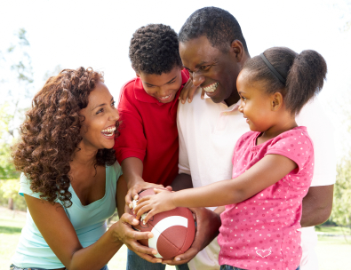 family holding football