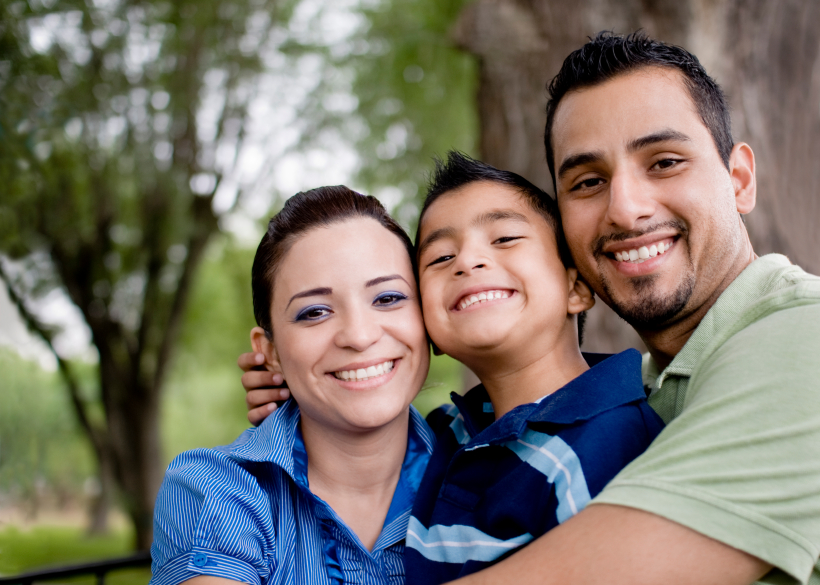 family in front of tree