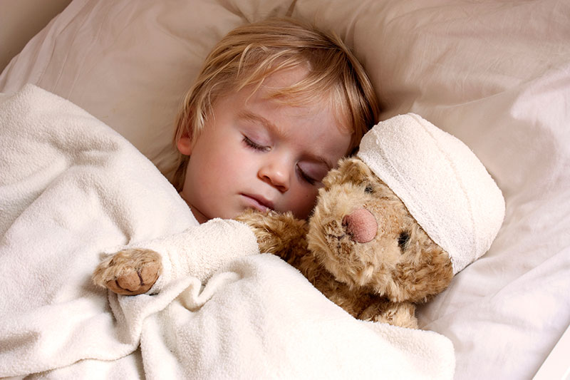 child sleeping with bear