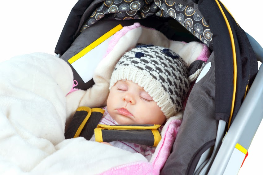Infant bundled in carseat