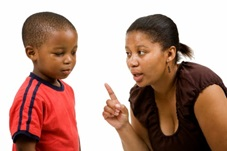 Woman scolding young boy