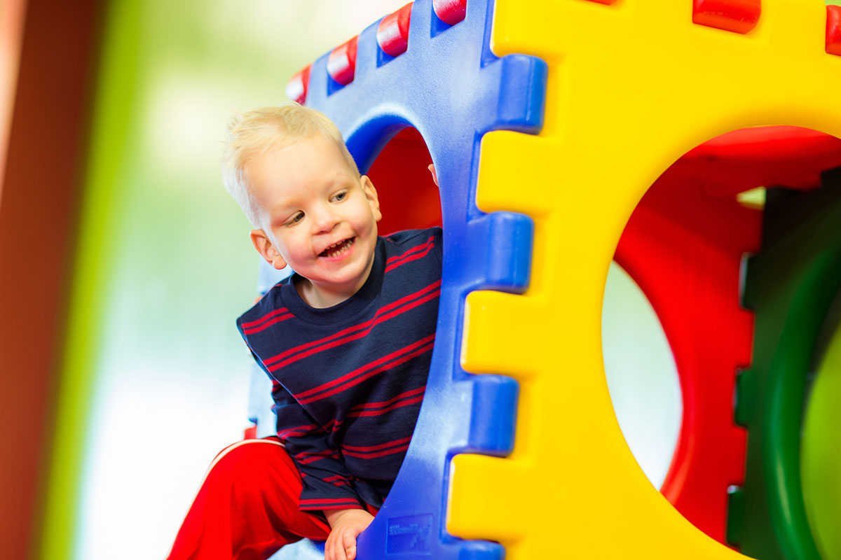 boy playing in play structure