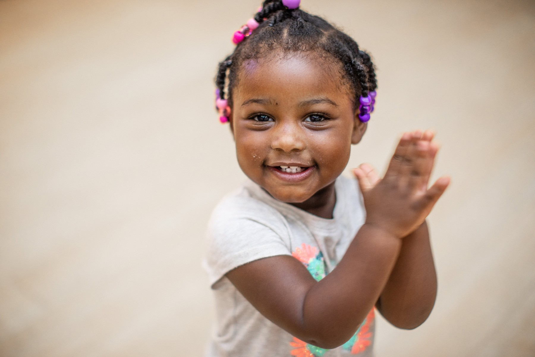 Girl Smiling and Clapping