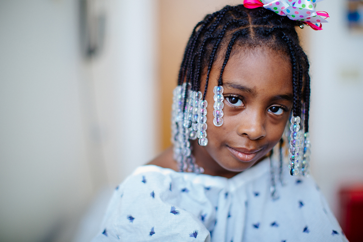patient with braids and beads