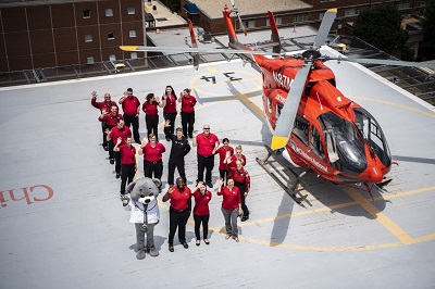 Children's National Sky Bear Transport Team on the hospital rooftop helipad next to helicopter