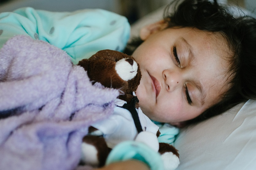 boy patient sleeping with bear