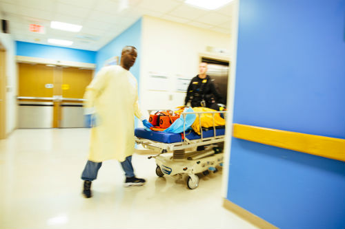 Patient being wheeled into Children's National Pediatric Level I Trauma Center for emergency trauma and burn surgery.