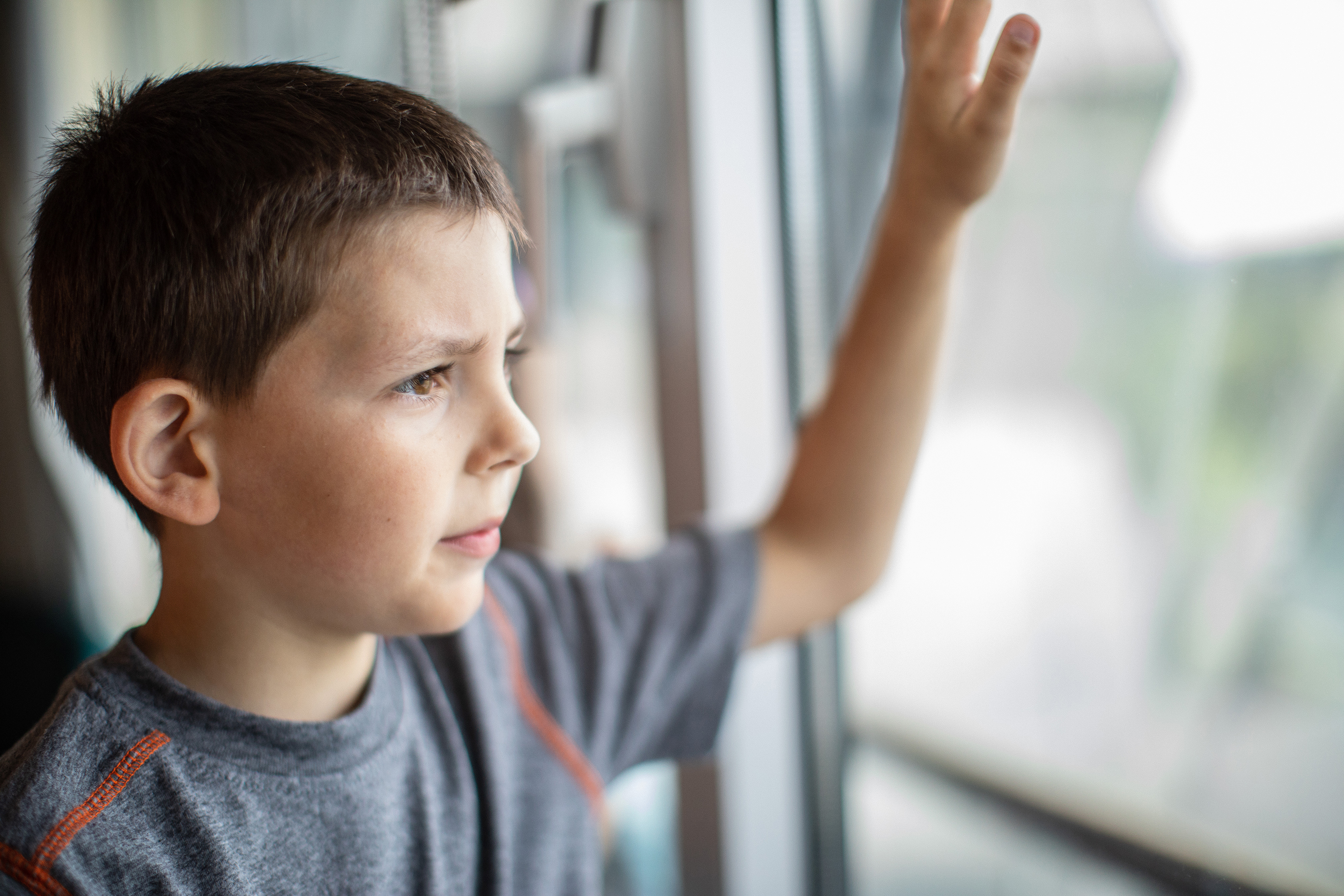 Young Boy Patient Looking Out Window