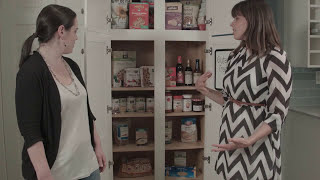 women standing in front of pantry