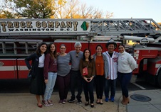 Children's National Craniofacial staff and volunteers stand in front of fire truck for a photo