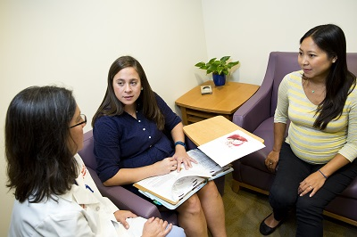An expectant mother meets with staff from the Fetal Medicine Institute