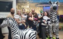 family with toy zebras