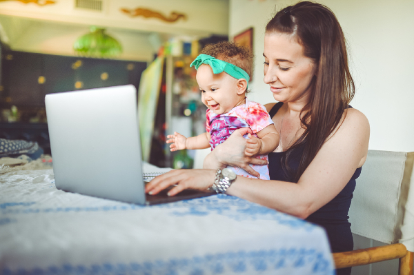 mother with baby at a computer