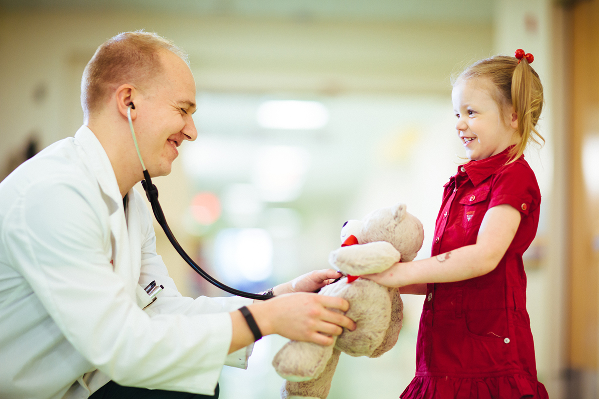 provider and girl with dr bear stuffed animal