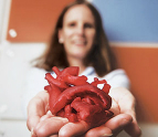 Laura Olivieri holding a 3-D printed heart