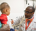 Dr. Andrew Campell examines a child