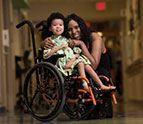 Child in wheelchair with mom