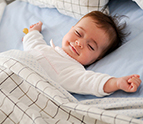 Smiling baby sleeping