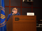 Lauri Tosi speaks at the NIH