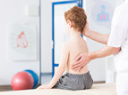 boy with scoliosis doing rehabilitation