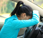 Stressed teen leaning against the steering wheel