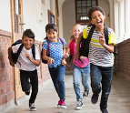 Kids running in school hallway