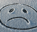 Frown face drawn in the snow