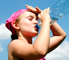 Girl drinking water in the sun