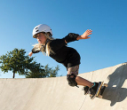 Girl skateboarding at a skate park