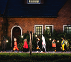 Group of kids-with Halloween costumes walking to trick-or-treating