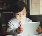 Young boy playing on tablet