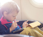 Toddler using a tablet on an airplane
