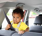 little girl sitting in car