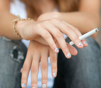 Teenage girl holding a cigarette