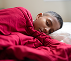 boy sleeping in bed