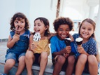 four young girls eating ice cream