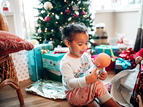 little girl opening gifts