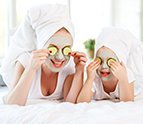 mother and daughter doing face masks