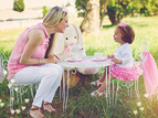 mom and daughter having tea party