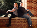 teen siblings sitting on a wall