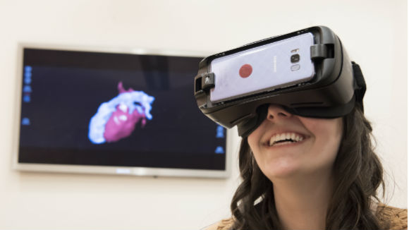 Teenage girl wears VR headset, which uses AlgometRx technology to measure pain levels.