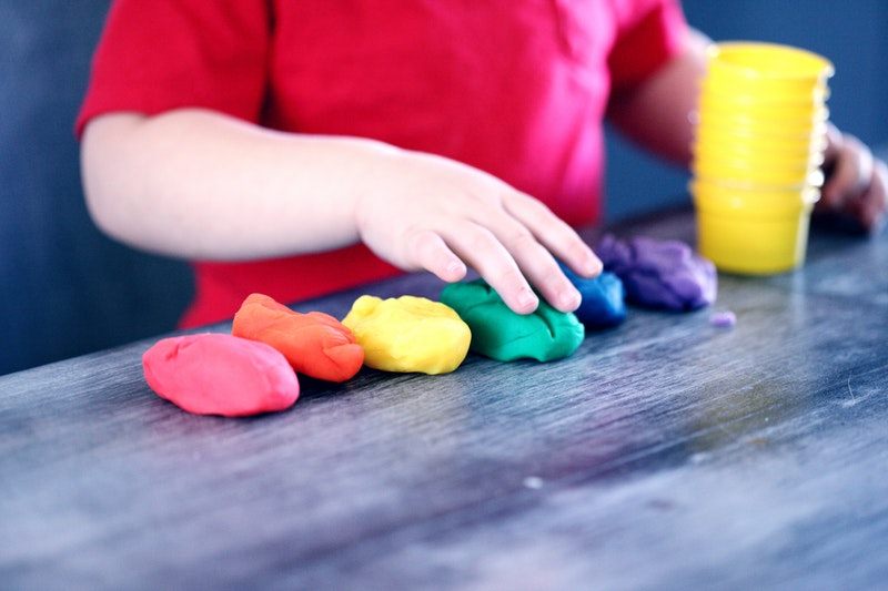 child playing with playdoh