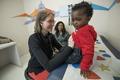 A young patient is examined at Children's Pediatricians & Associates Capitol Hill.