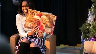 First Lady Michelle Obama in 2014 displays book to her young listeners