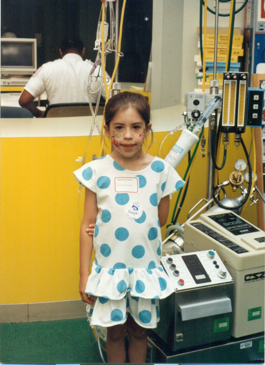 Emilee next to the ECMO equipment that saved her life as a baby.