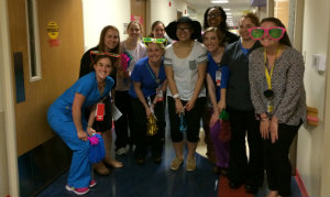 Carly and her Children's care staff smile for camera