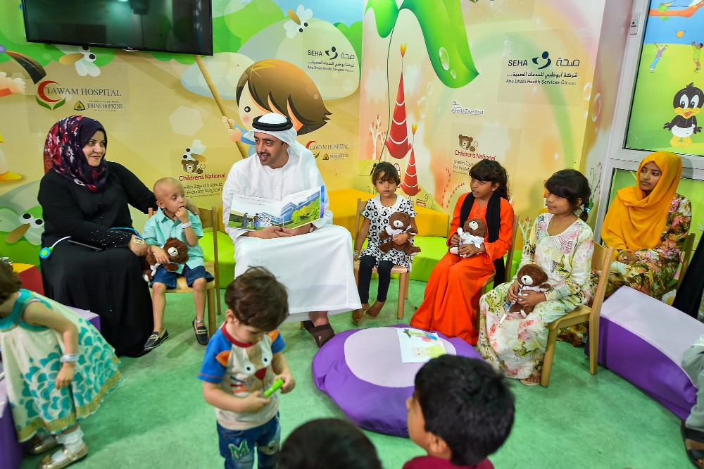 His Highness Sheikh Abdullah reading to children