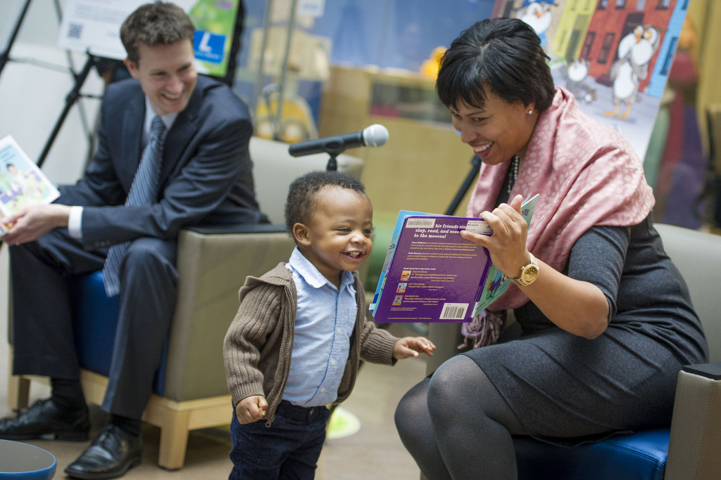 Mayor Muriel Bowser reads to an enthusiastic young listener
